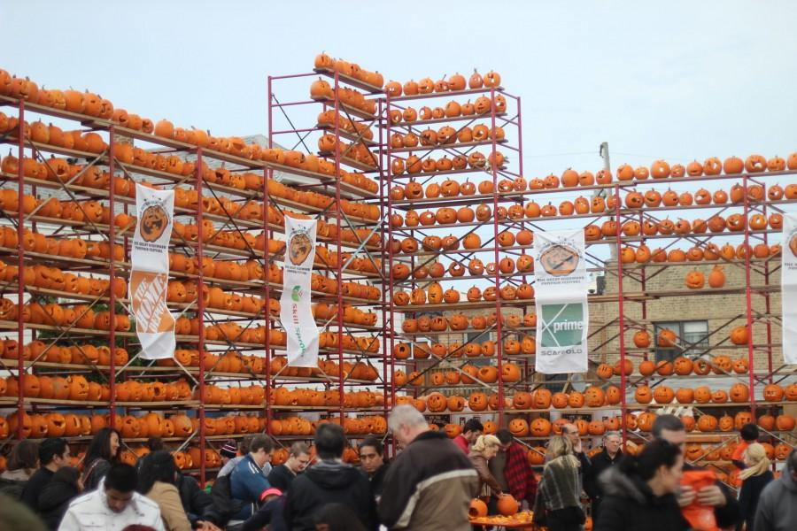 THE+GREAT+WALL%3A+The+21%2C000+pumpkins+carved+during+Pumpkin+Fest+were+displayed+on+racks%2C+some+of+which+soared+beyond+50+feet+in+height.+These+walls+of+pumpkins+stretched+across+the+festival+grounds.+During+the+nightly+lighting+ceremonies%2C+spectators+watched+as+these+walls+were+illuminated+with+carved+faces%2C+shapes+and+symbols.