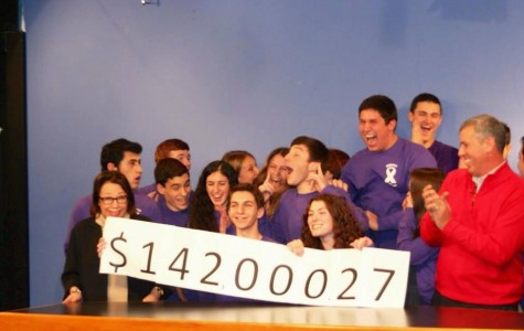 RECORD-BREAKING YEAR: Student Council members celebrate as the total amount of money raised for School Chest is announced. This year's fundraiser, which will support the Rolfe Pancreatic Cancer Foundation, collected the most money in DHS history at nearly $142,000.