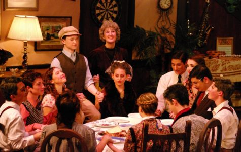 The Sycamore family in You Can't Take it With You gathered around the dinner table. (Image courtesy of  the official DHS Friends of the Arts Facebook  page.)